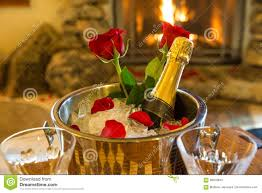 romantic room with champagne bucket and roses stock photo image
