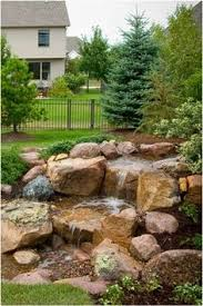 Backyard Waterfall Ideas by Build A Backyard Waterfall And Stream Dreaming Gardens Crafty