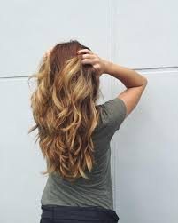 long wavy straight strawberry blonde hair with long layers and a