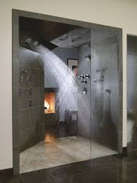 elegant bathroom with glass door and amber coloured marble floor