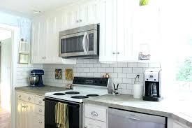 kitchen with glass backsplash white kitchen gray backsplash midtree co