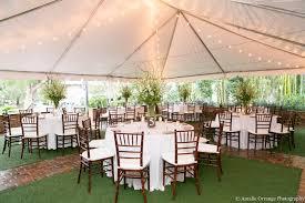 mahogany chiavari chair white top tent with market lighting and mahogany chiavari chairs