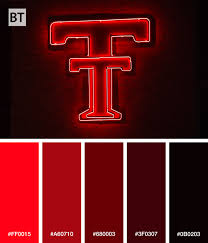 texas tech neon light color palette of the double t neon sign on the side of jones at t