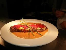 magnet cuisine 8oz sirloin steak with chorizo sausage and a chorizo sauce