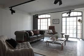 sophisticated industrialism revealed in a london apartment luxury loft apartment living room design