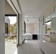 wet room bathroom modern with skylight handle tub and shower