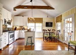 vaulted kitchen ceiling ideas vaulted ceiling track lighting white and blue kitchen with wood
