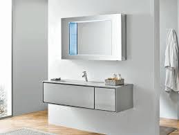 sleek rectangular mirror with chrome frame plain white wall paint