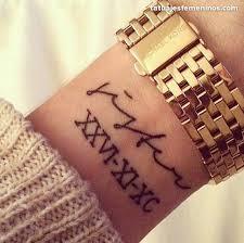 51 roman numerals wrist tattoos