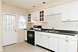 white kitchen cabinets with black countertops