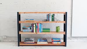 Free Standing Wood Shelves Plans by How To Make An Ironbound Diy Bookcase Out Of Angle Irons And 2x10s