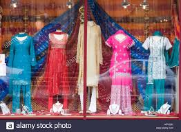 indian clothes for sale in a shop window display stock photo