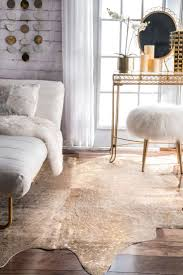interior fancy cowhide rugs and furry stool plus orchid flower