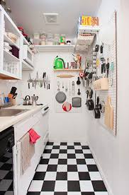 White Small Kitchen Designs by Small Kitchen Design With Cutlery Cabinet And Appliances Shelves