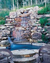 exterior design pictures of backyard waterfalls with wood fence