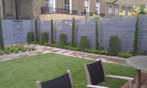 garden trellis design modern planting easy grass grey trellis screen sandstone paving