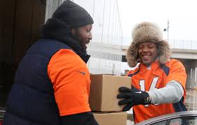 broncos get into the charitable thanksgiving spirit with the