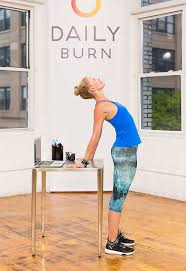 Desk Yoga Poses 5 Standing Desk Stretches To Relieve Stress Now Daily Burn