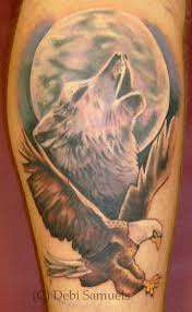 wolf howling at moon with eagle com
