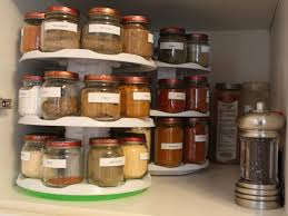 how to organize a lazy susan cabinet how to organize your spice cabinet or drawer delishably