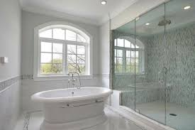 bathroom glass mosaic tile with clear granite bathtub also