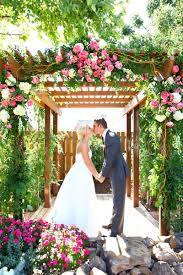 wedding trellis rose petals on grass in front of beautiful