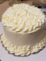 4 flavor vanilla 2 layer cake with lush buttercream frosting and