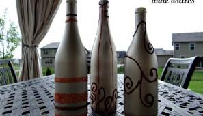 Upcycled Wine Bottles - embellished upcycled wine bottles sprinkled nest