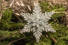 white ice skate christmas decoration on green christmas tree stock