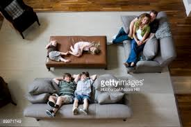 Family Sitting On Sofa In Living Room Stock Photo Getty Images - Family in living room