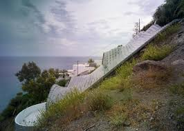 amazing dragon inspired cliff house in spain uses earth