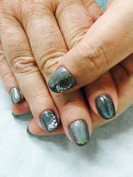 holo chrome unicorn effect stamped gel nails gel nail designs
