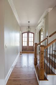 Hall And Stairs Paint Ideas by Foyer With Behr Sculptor Clay And Silky White Trim Revere Pewter
