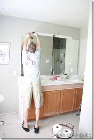 Framing Existing Bathroom Mirrors by Remodelaholic Framing A Large Bathroom Mirror