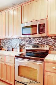 what color backsplash with wood cabinets updating wood kitchen cabinets remodeled