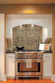 the painted cabinets give the space a fresh and clean feel while