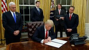 washington president trump sign his first executive order
