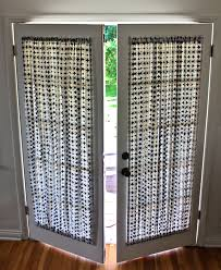 interior french patio doors with white blinds roll up comboned