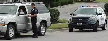why do police touch the tail light why do police officers touch the rear of cars during traffic stops