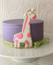 baby shower giraffe cake maybe this with flower cookies on side