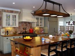 wood countertops black glass kitchen backsplash black metal pull