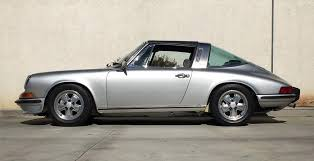 4 door porsche for sale this electric porsche 911 targa uses a battery from a crashed tesla