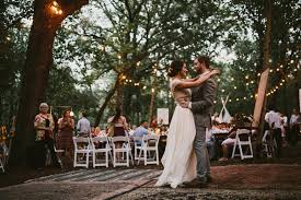 diy backyard wedding in the woods reception string lights first