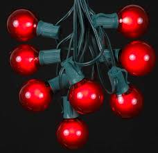 satin g50 globe outdoor string light set on green wire