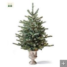 realistic looking artificial pre lit and easy to set up tree