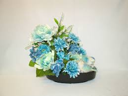 silk flower arrangement in a ceramic dish with blue and mint green