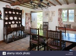 period small cottage dining room with tile floor oak furniture