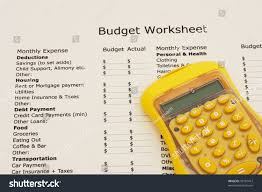 How To Set Up A Monthly Budget Spreadsheet A Budget Worksheet With A Calculator Creating Your Budget Stock