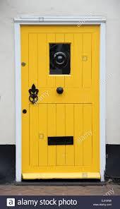 yellow cottage front door uk stock photo royalty free image