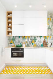 design white kitchen storage yellow green splashback classic chic
